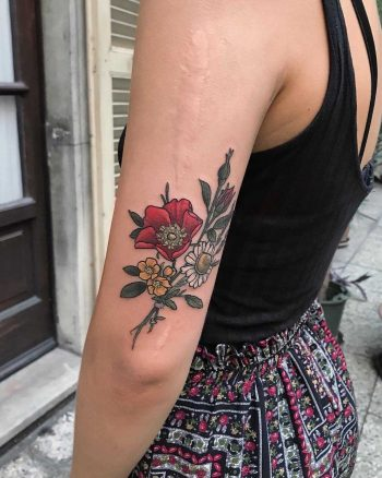 Wild rose daisy and buttercups tattoo