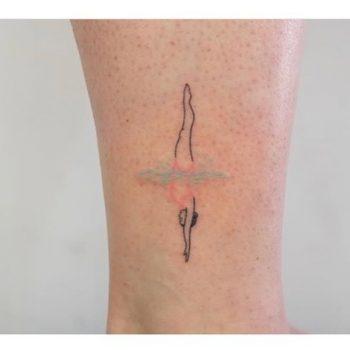 Woman diver tattoo