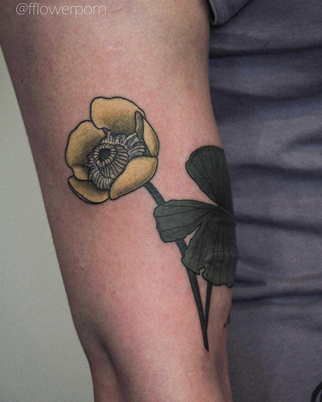 Yellow water lily tattoo
