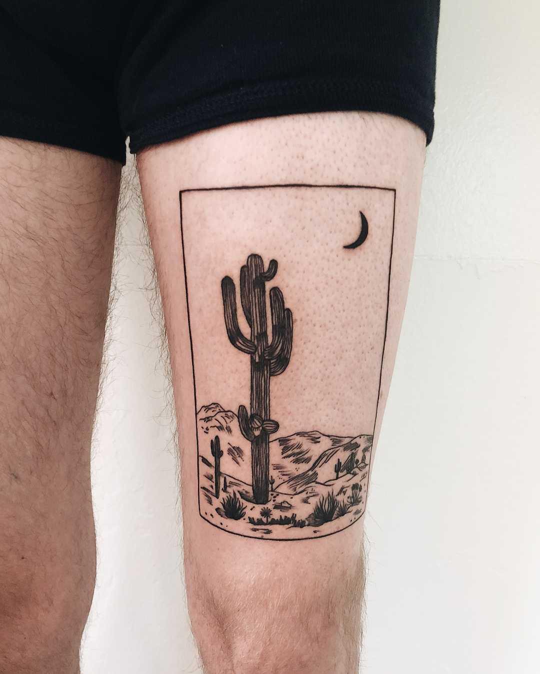 A desert moon tattoo