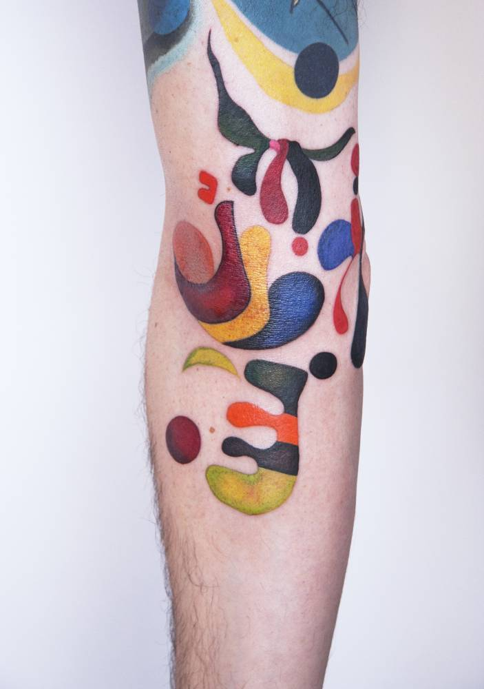 Abstract colorful tattooed arm