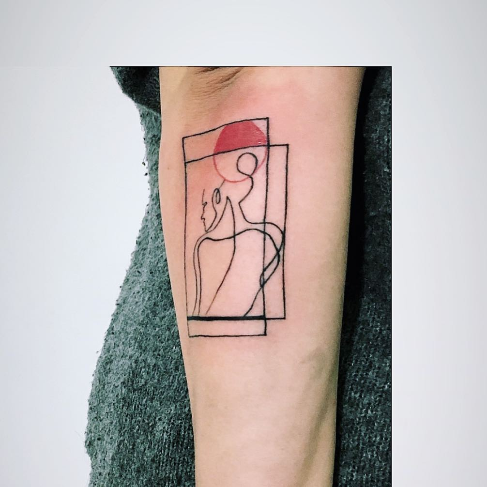 Abstract silhouette tattoo on the forearm