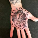 Anatomical heart on the palm
