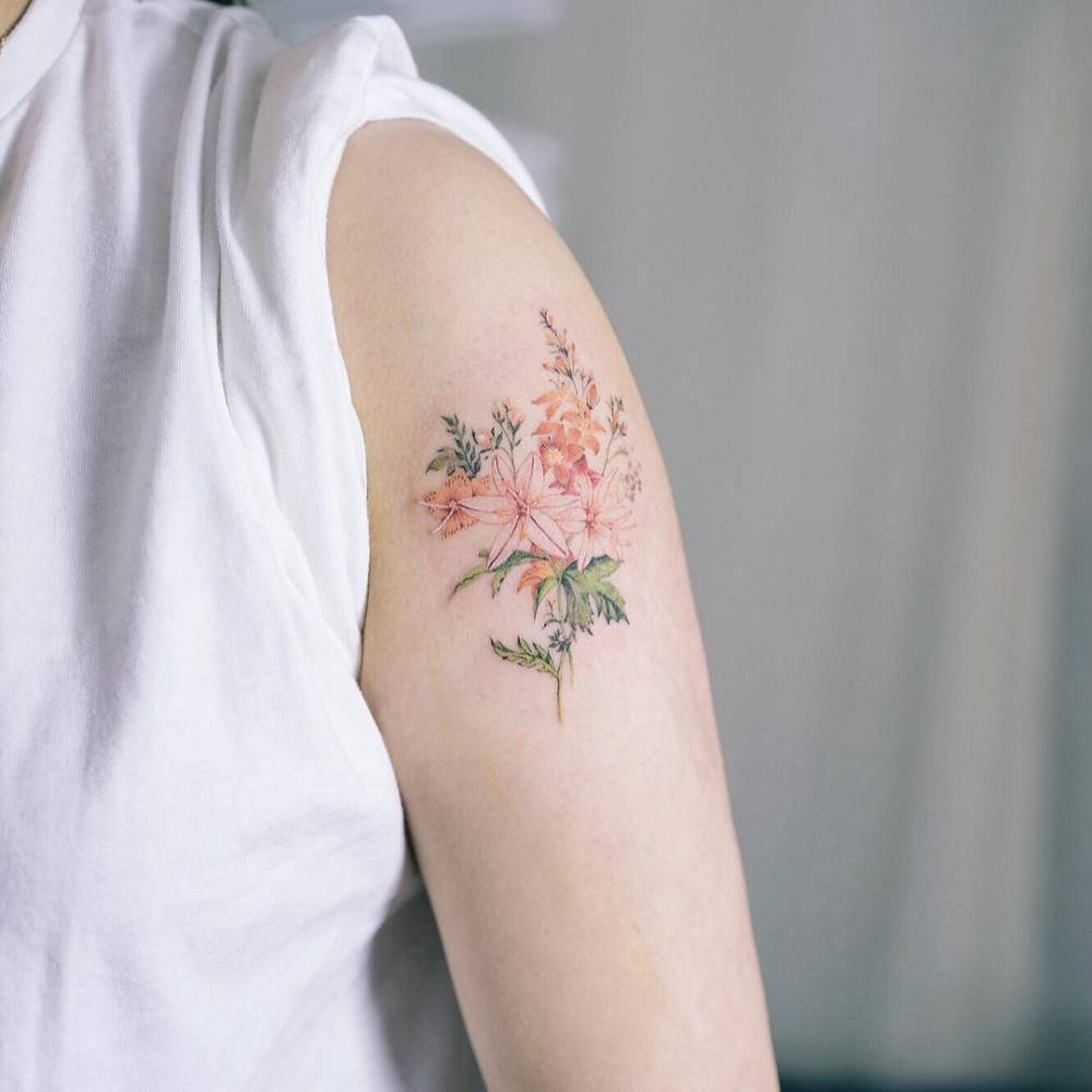Beautiful and delicate flower on the left arm