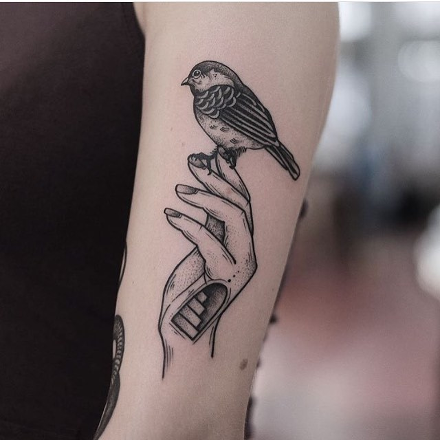 Bird on a hand tattoo by Jonas Ribeiro