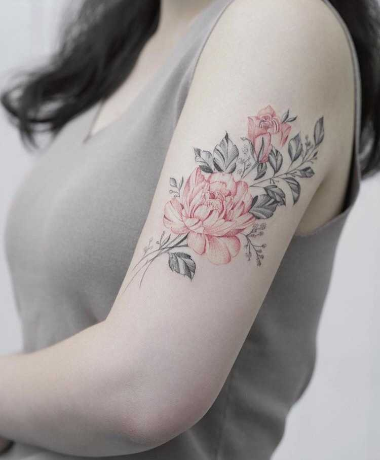 Black and red rose tattoo on the left arm
