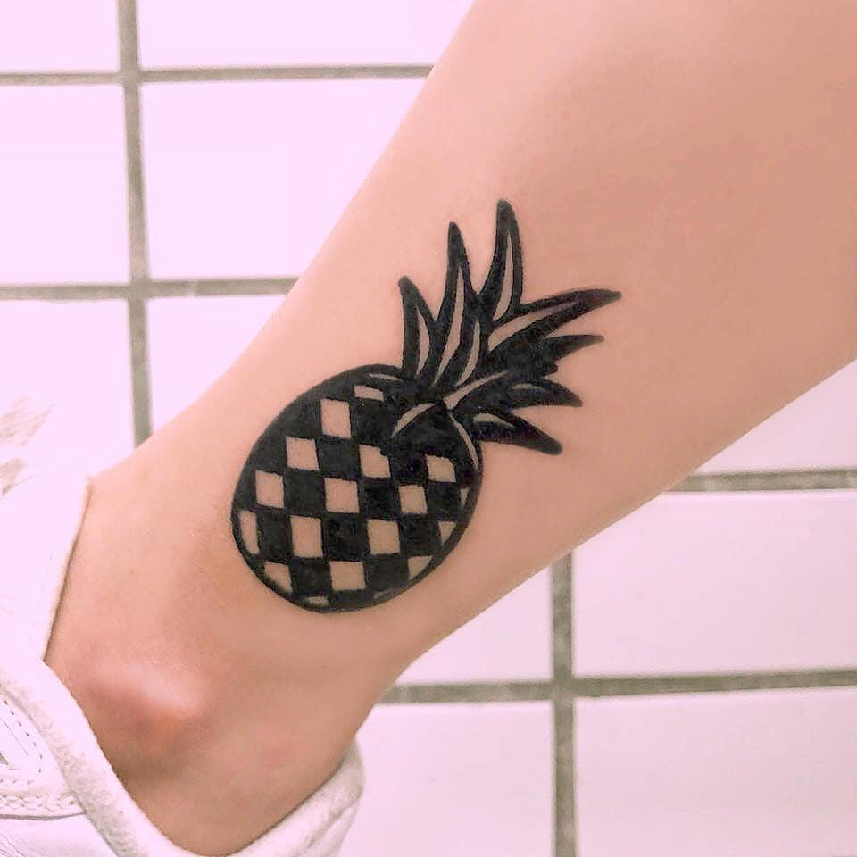Black and white pineapple tattoo