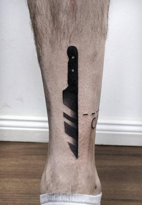 Black dot-work knife tattoo