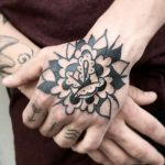 Black flower tattoo by Jay Lester