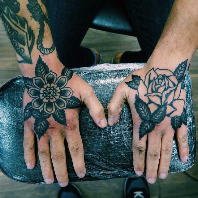 Black flower tattoos by Rich Hadley