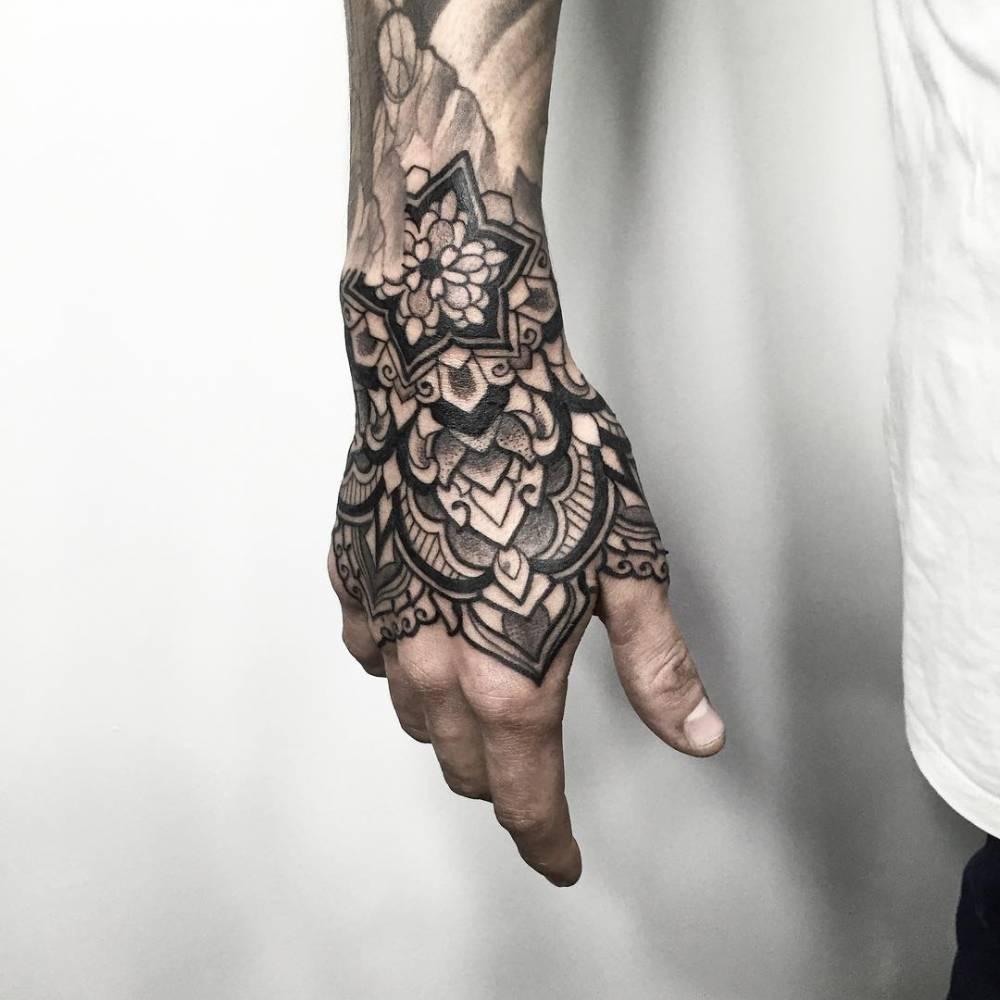 Black ornamental tattoo on the right hand