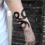 Black snake tattoo by Andre Castcovil