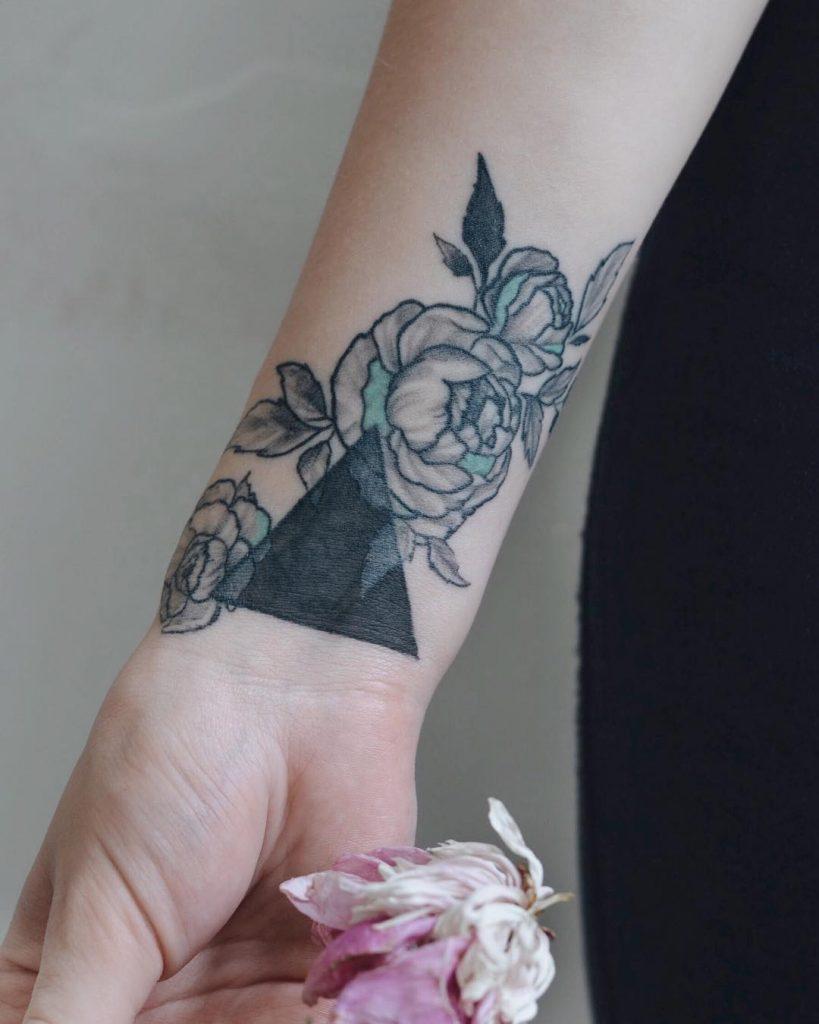 Black triangle and rose tattoo