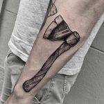 Blackwork ax tattoo