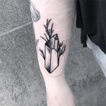 Blackwork crystal and branch tattoo