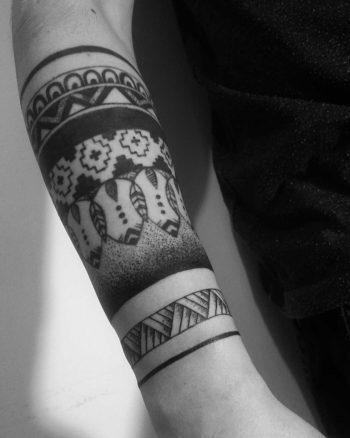 Blackwork pattern tattoo on the forearm