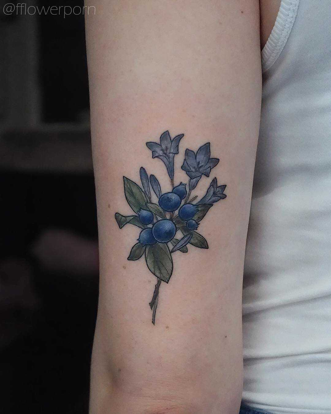Blueberry with agapanthus flowers tattoo