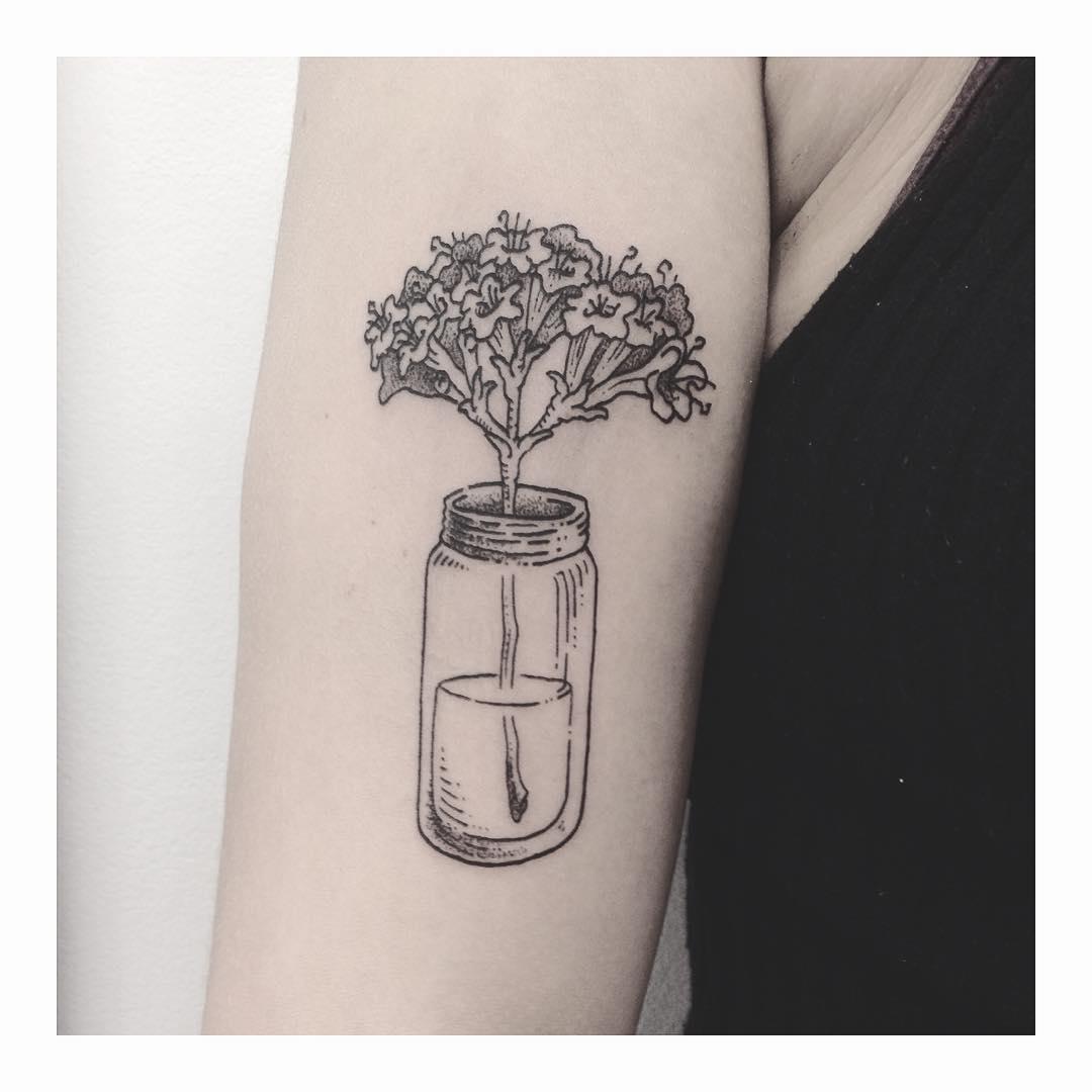 Bouquet in a jar tattoo