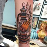 Broken lantern tattoo by Chris Collins