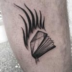 Burning book tattoo