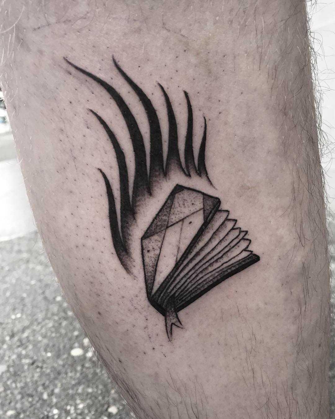 Burning book tattoo