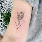 Child's birht mark flower bouquet tattoo