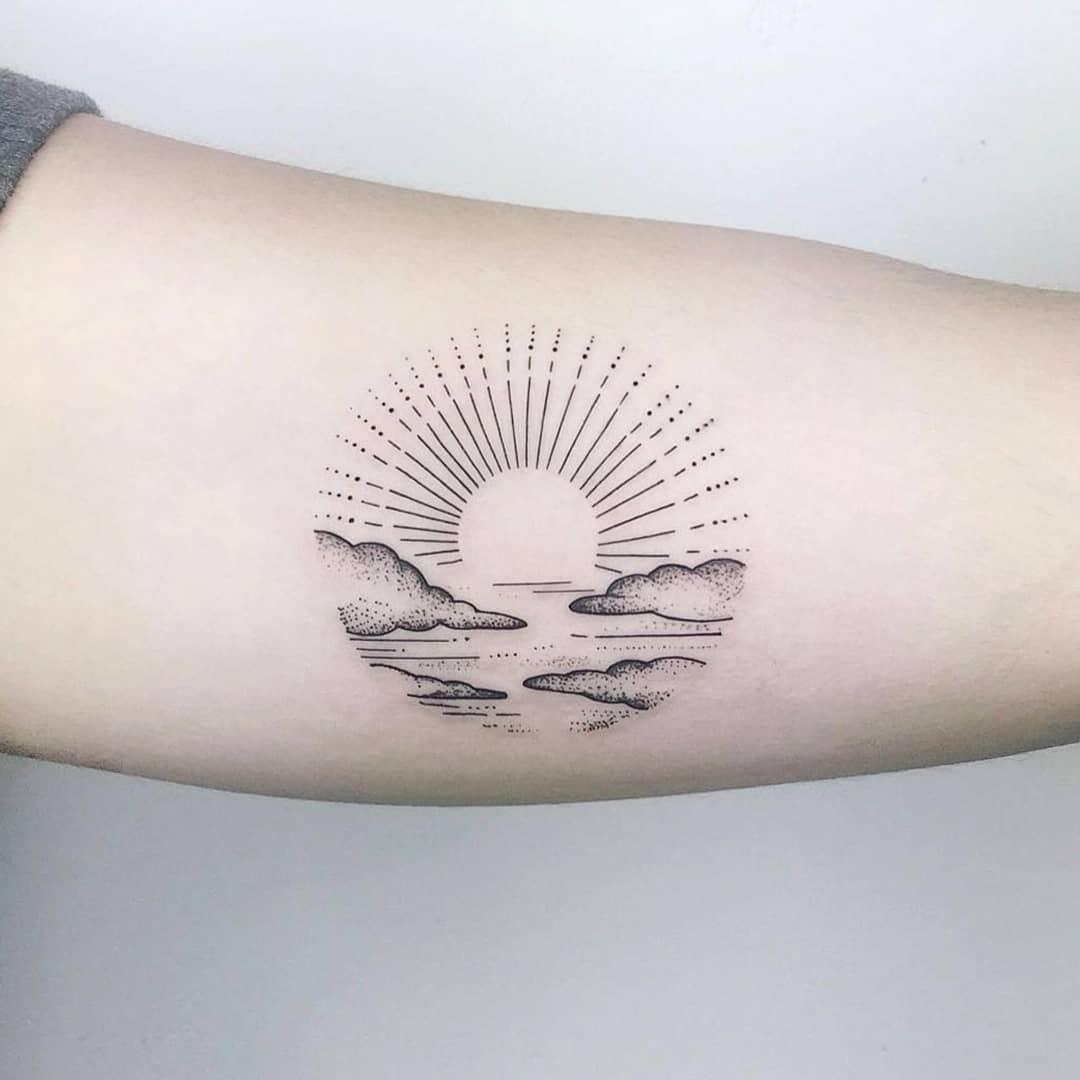 Circular sunset tattoo