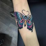 Colorful butterfly tattoo by Raro