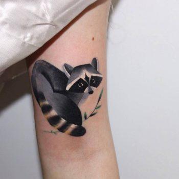 Colorful raccoon tattoo