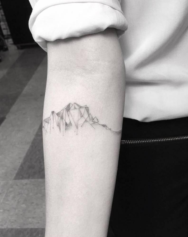 Cubist mountain range tattoo