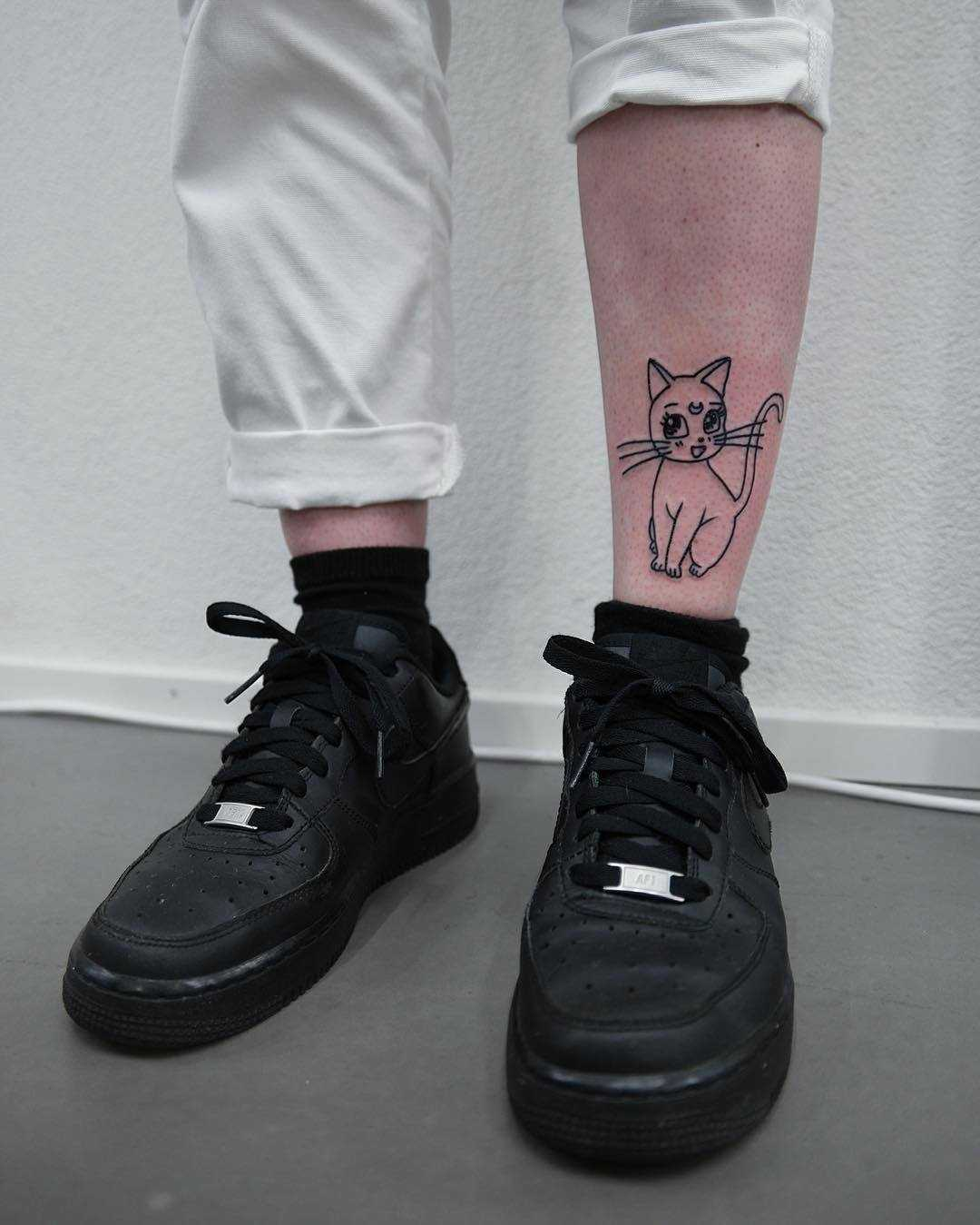 Cute cat tattoo on the shin