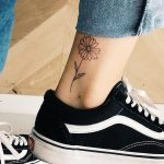 Daisy tattoo on the ankle