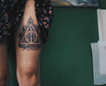 Deathly Hallows tattoo on the thigh
