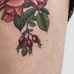 Detailed rosehip tattoo