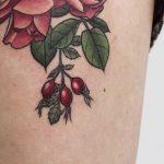 Detailed rosehip tattoo