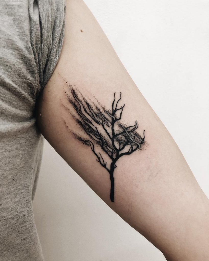 Disappearing tree tattoo