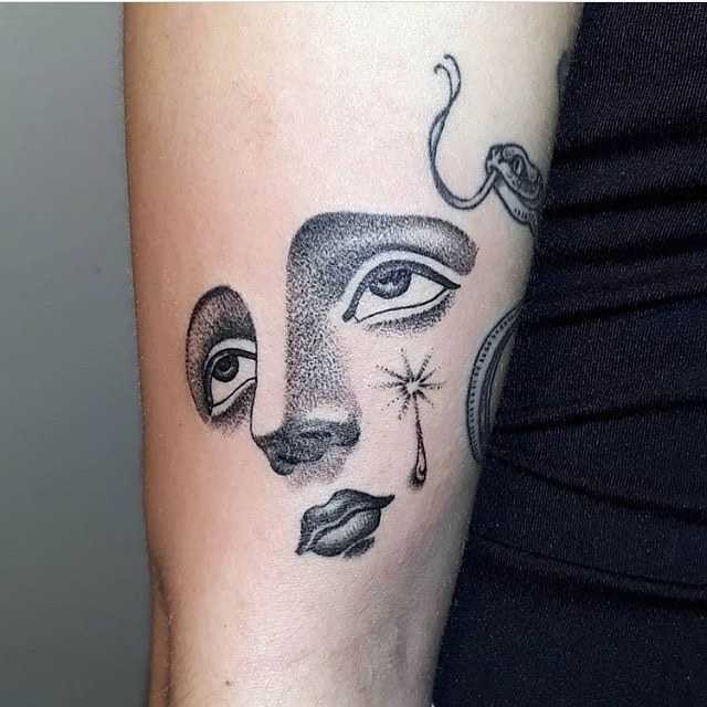 Dot-work face tattoo