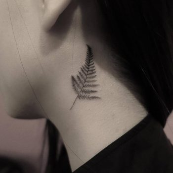 Fern leaf tattoo on the neck