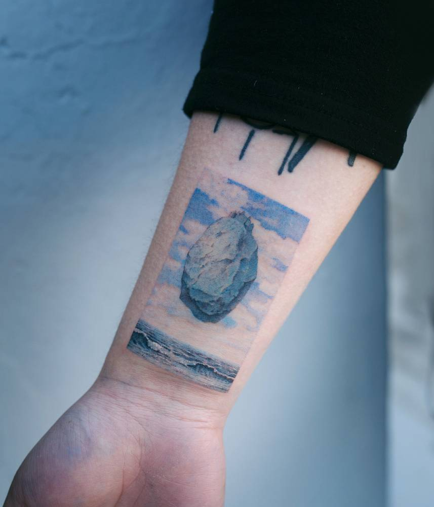 Floating rock tattoo by Sol