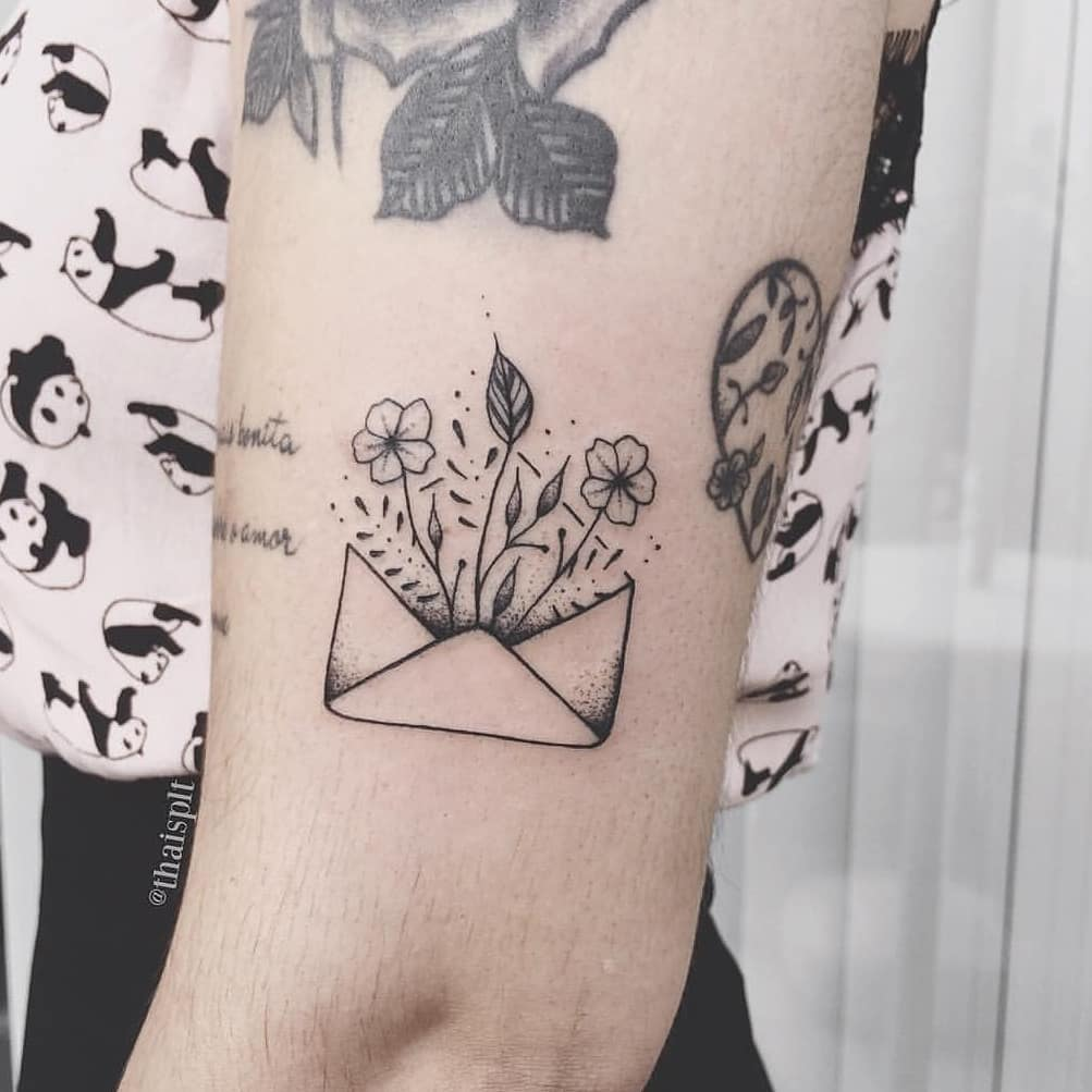 Floral letter tattoo