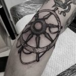 Freehand shipwheel tattoo