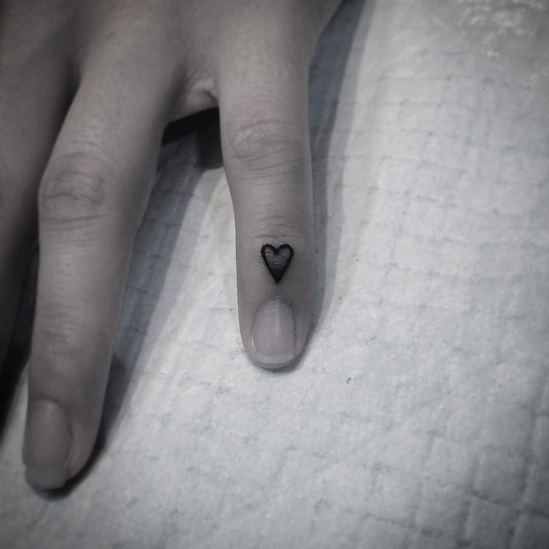 Hand-poked heart tattoo by Hurricane