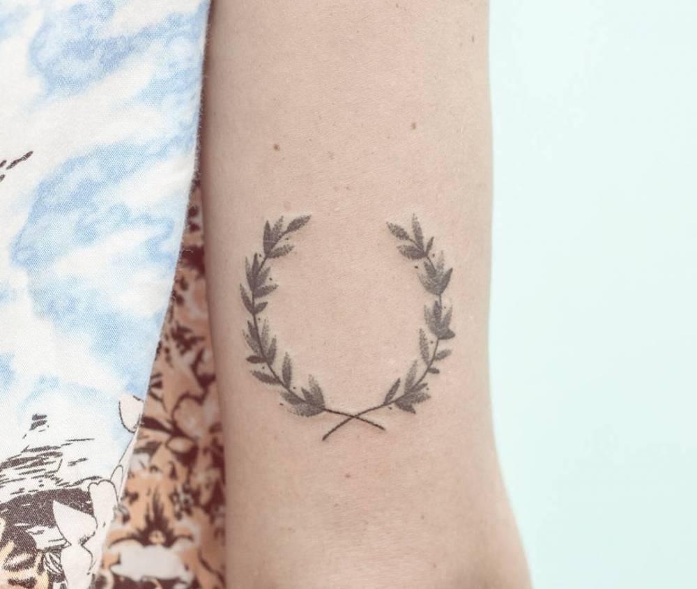 Hand-poked laurel wreath tattoo