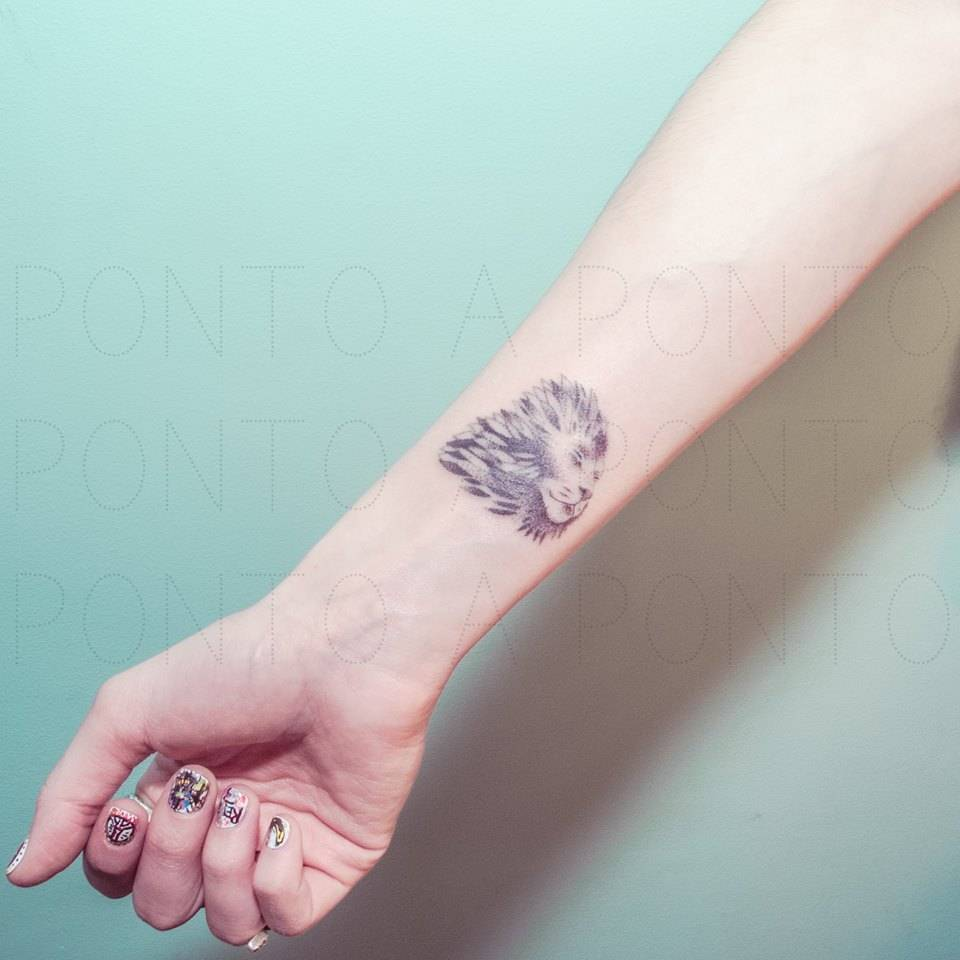 Hand poked lion on the wrist