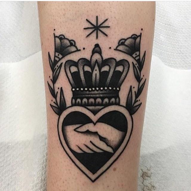 Handshake and crown tattoo by Jeroen Van Dijk