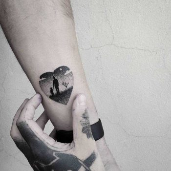 Heart-shaped father and daughter tattoo