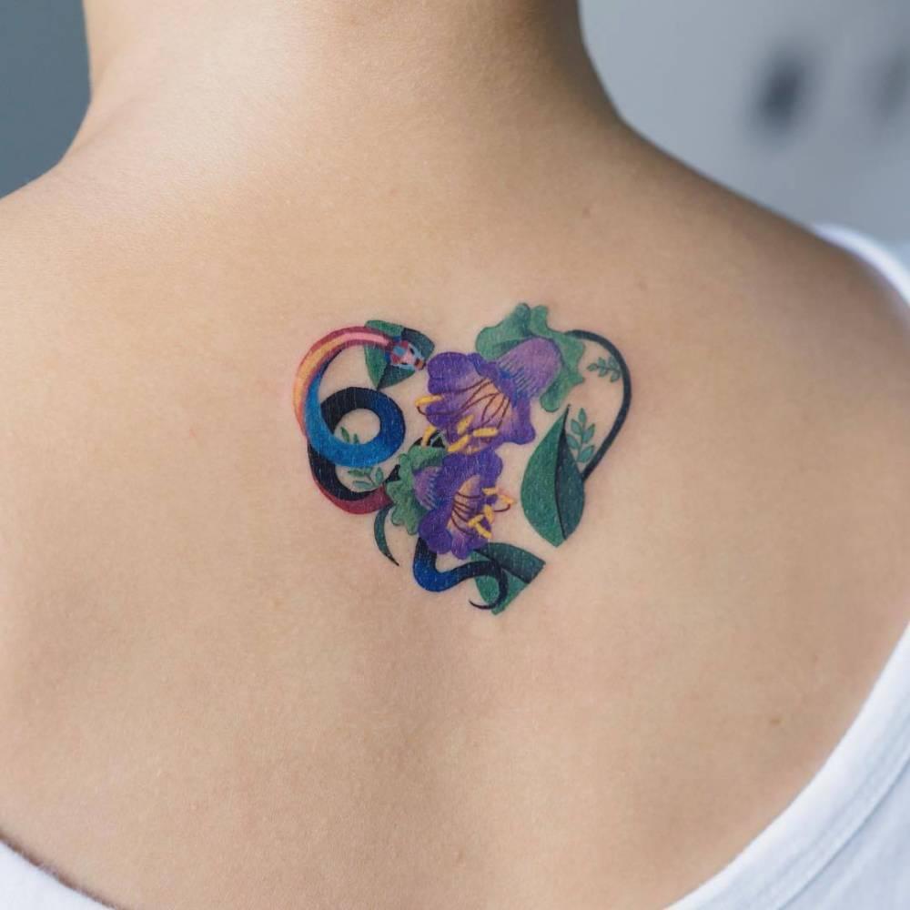 Heart-shaped floral tattoo by Zihee