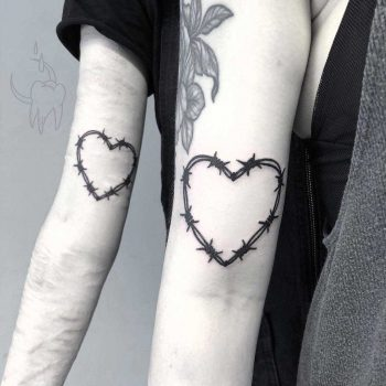 Heart-shaped matching wire tattoos
