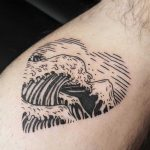 Heart-shaped wave and mountain tattoo