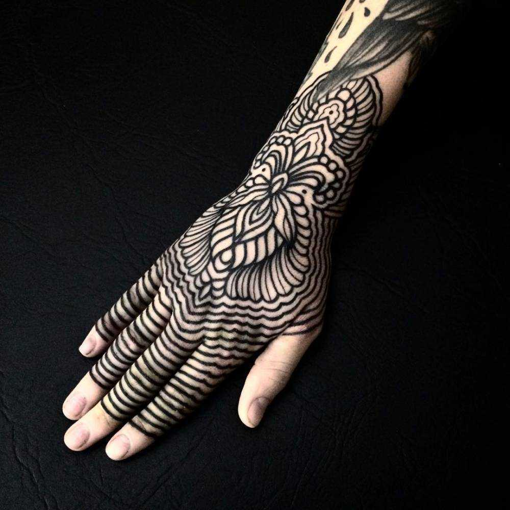 Henna-inspired tattoo on the hand